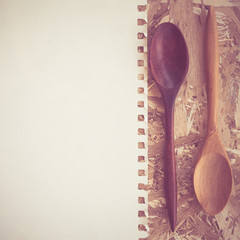 wooden spoons on a wooden background
