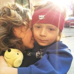 Mother son morning hug