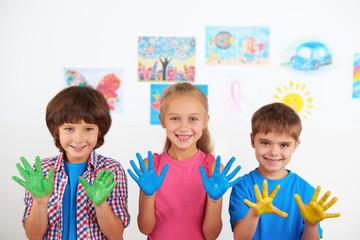 Happy children showing painted hands