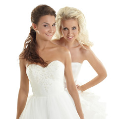 Charming models posing in wedding dresses