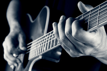 playing country guitar