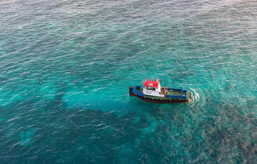 Red White and Blue Pilot Boat in Shallow Aqua Water