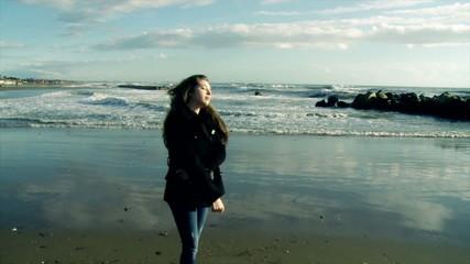 Girl looking ocean in tempest slow motion hand held