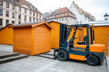 Forklift arranging market stall