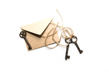 Three old key and envelope on a white background