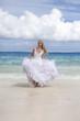 beautiful woman runs on the edge of the sea . Polynesia...