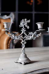 beautiful candlesticks with angels borokko on the table