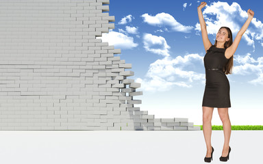 Beautiful businesswoman in dress happily raised his hands up