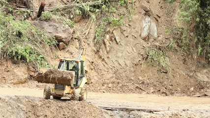 Clearing a landslide on a dangerous mountain road