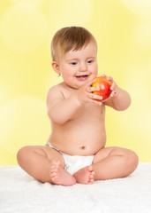 adorable happy baby with apple