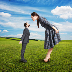 beautiful woman kissing small man