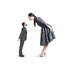 woman bending forward and kissing small man