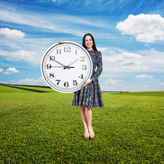 woman holding big clock and looking