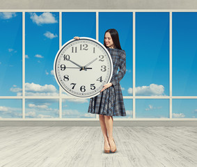woman looking at big clock
