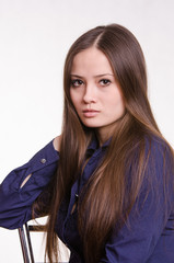 Portrait of girl in a blue blouse