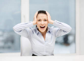 angry screaming businesswoman in office