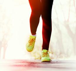 Runner feet on road, outdoors