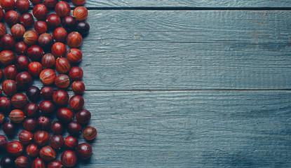 Berries gooseberries on wooden background
