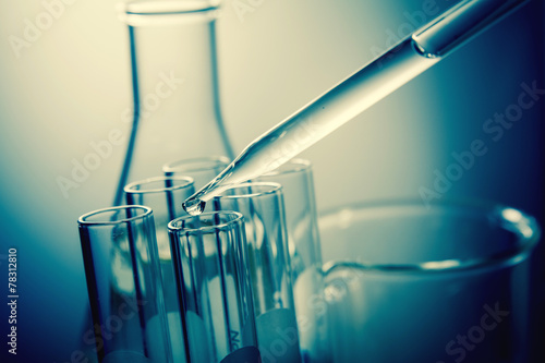 dropping liquid to test tubes - 78312810