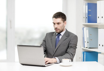busy businessman with laptop and coffee