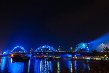 Blue Dragon bridge with water steam in Danang Vietnam