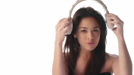 Happy young brunette woman wearing ear muff