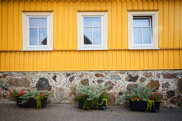Yellow wooden wall with some windows