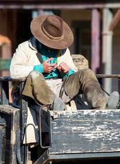 Cowboy sitting on a wagon at Mini Hollywood Almeria Spain