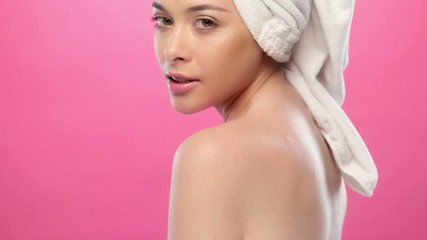 Portrait of young beautiful woman with the towel on her head