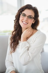 Smiling businesswoman with reading glasses