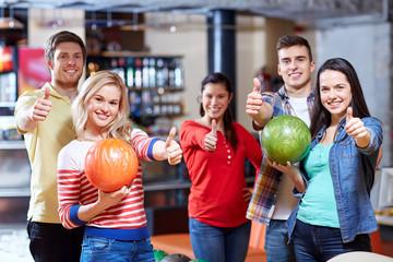 happy friends in bowling club