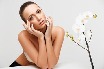 Spa Woman. Beautiful Girl Touching Her Face. Perfect Skin.