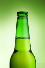 beer bottle over green background