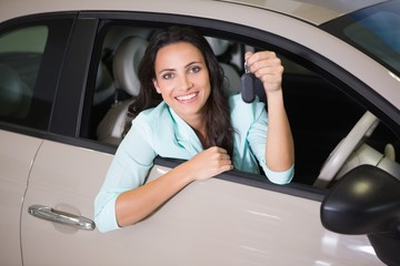 Smiling woman holding car key