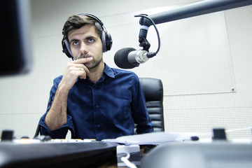 Radio presenter hosts the evening show on air