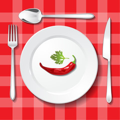 Hot chili pepper and parsley on white plate