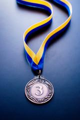 Bronze medal on a blue background