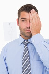 Businessman making an eye test