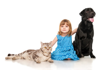 Little girl  with  dog and cat.