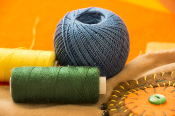 Multi-colored threads for sewing. Handmade. Creativity. Fashion.
