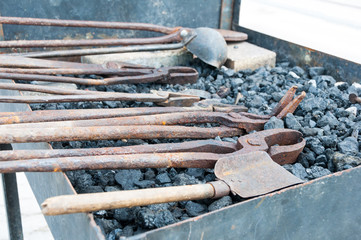 Rusty metal tools at forge