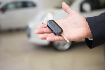 Close up of businessman holding car key