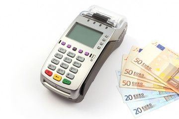 Bank terminal and money isolated on white