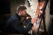 Professional painter at his art studio, - 78322609