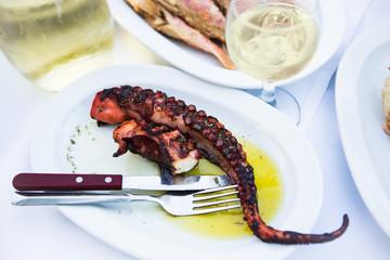 Grilled octopus in greek taverna
