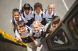 Cute schoolchildren getting on school bus - 78322891
