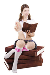 Sexy student girl sits on a stack of books