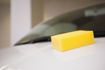 Close up of a yellow sponge on a car