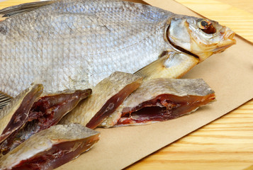 Bream on paper, on the wooden background