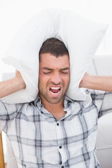 Screaming man with a pillow